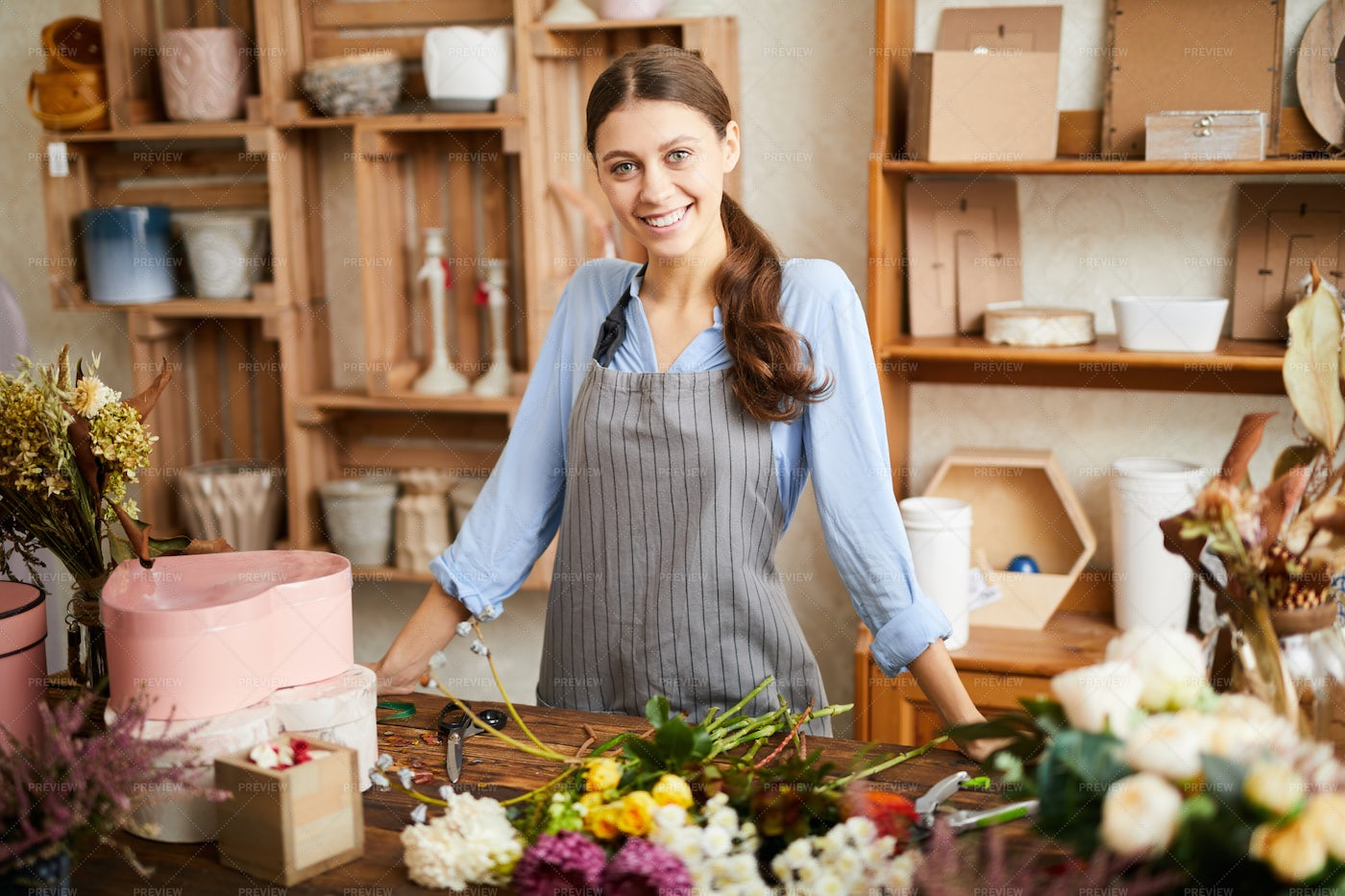 Smiling Florist In Shop: Stock Photos