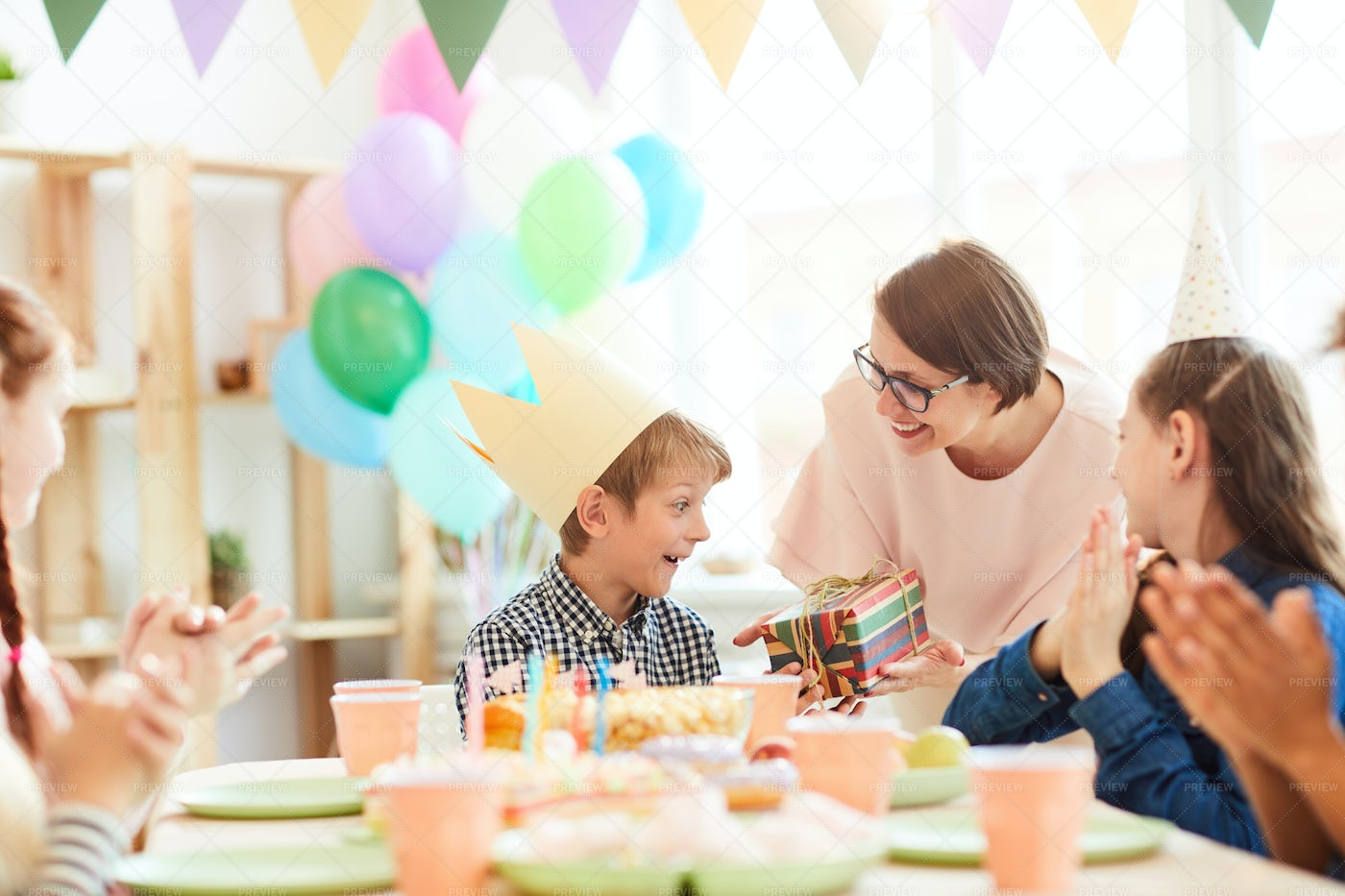 Excited Boy Getting Birthday Party: Stock Photos