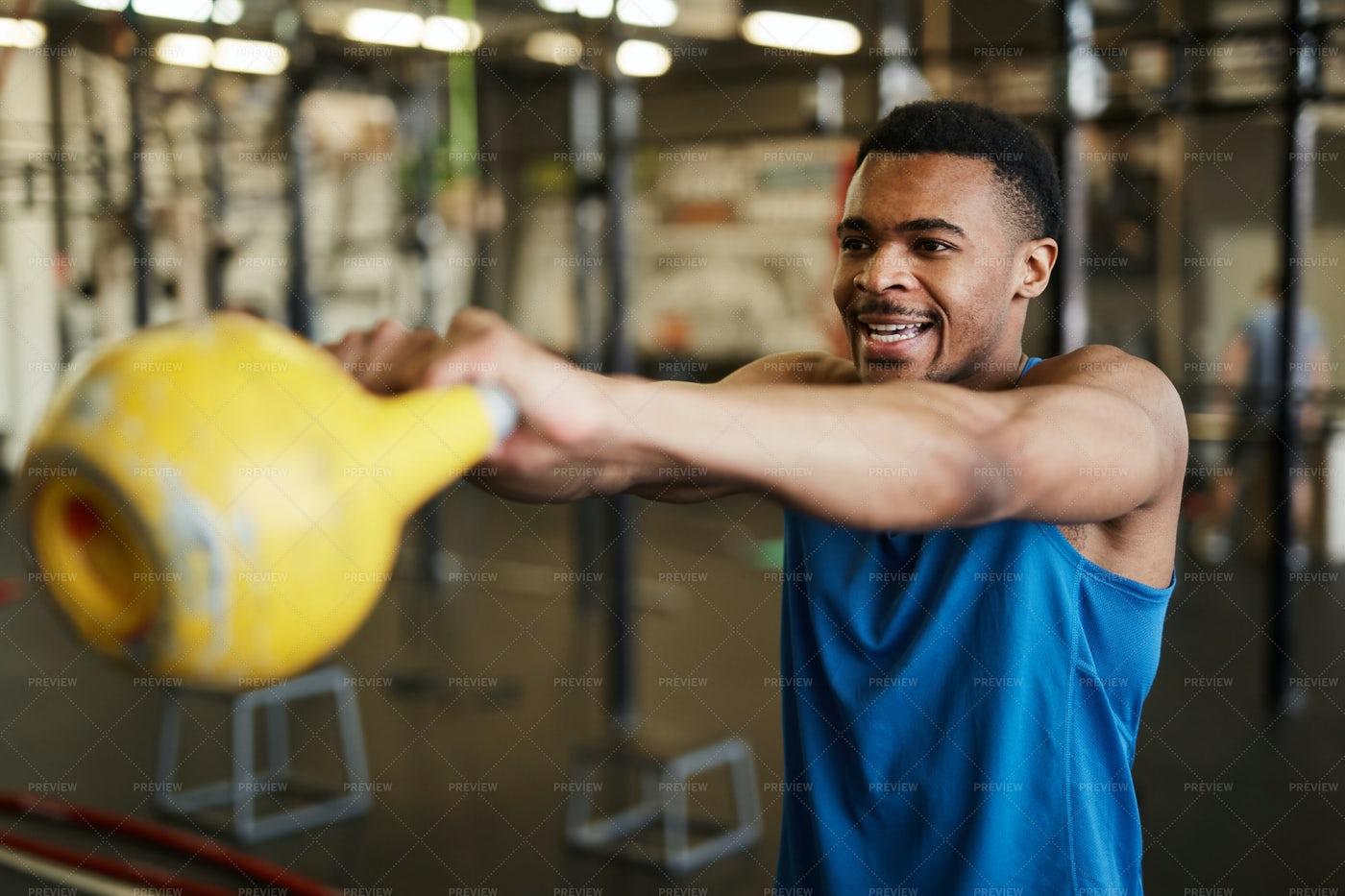 Strong Man Swinging Kettlebell: Stock Photos