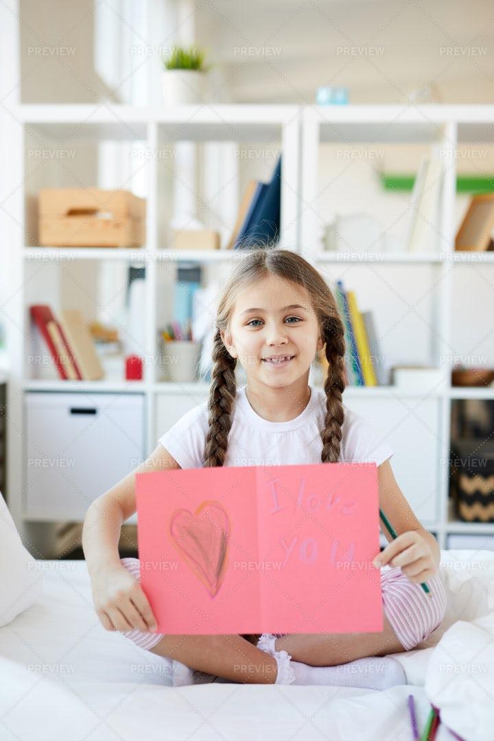 Girl Showing Handmade Card: Stock Photos
