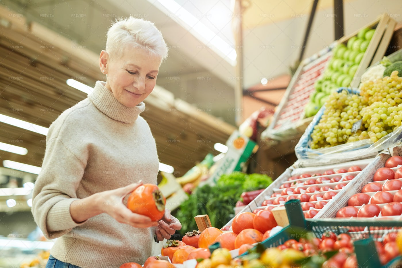 Woman Choosing Fresh Produce: Stock Photos