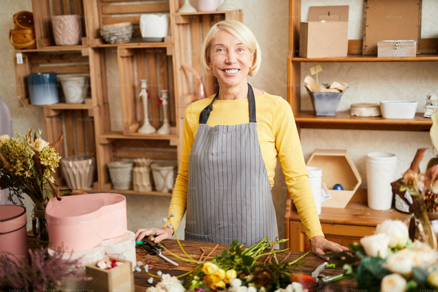 Mature Florist In Shop: Stock Photos