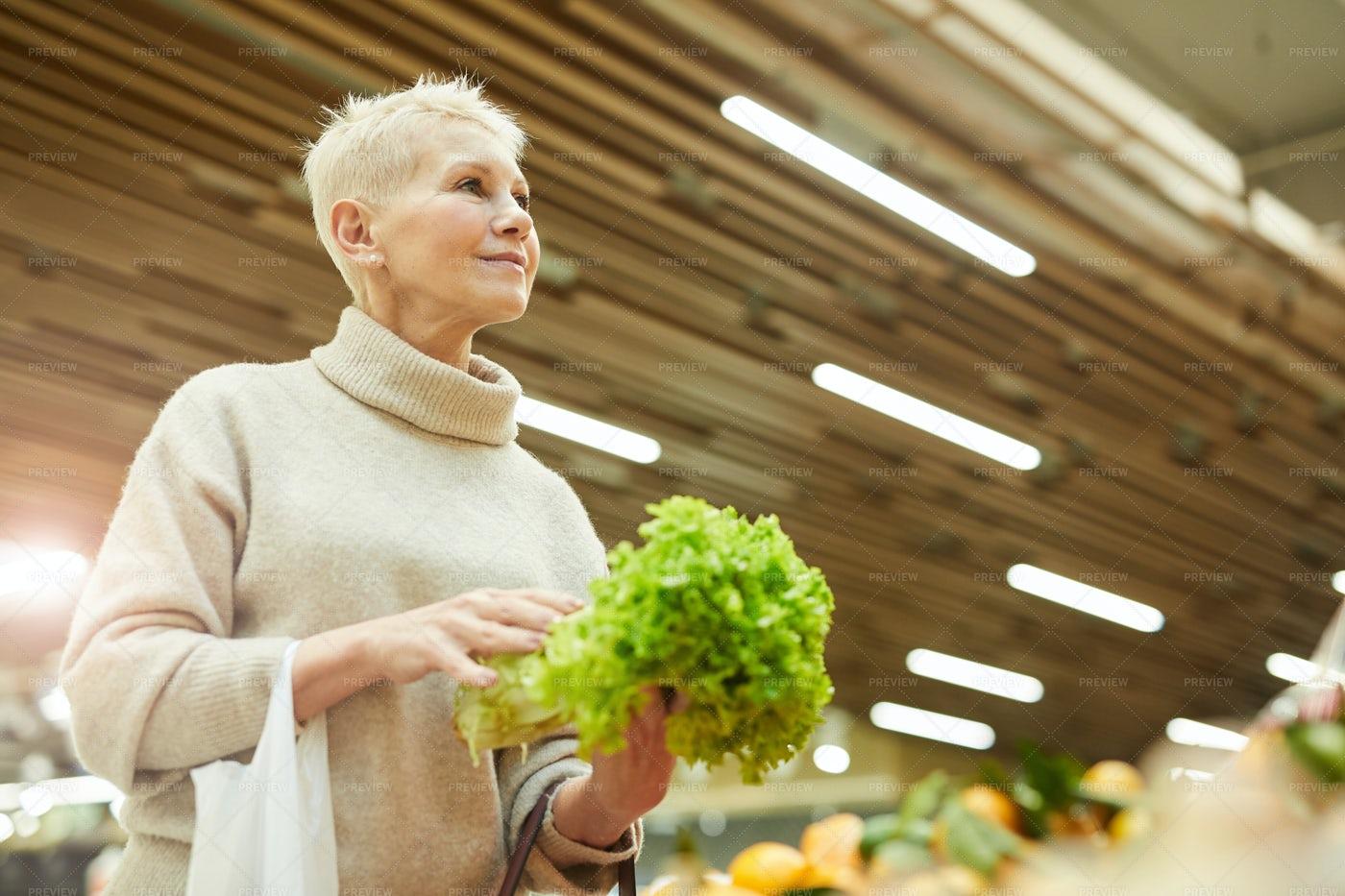 Woman Buying Fresh Vegetables: Stock Photos