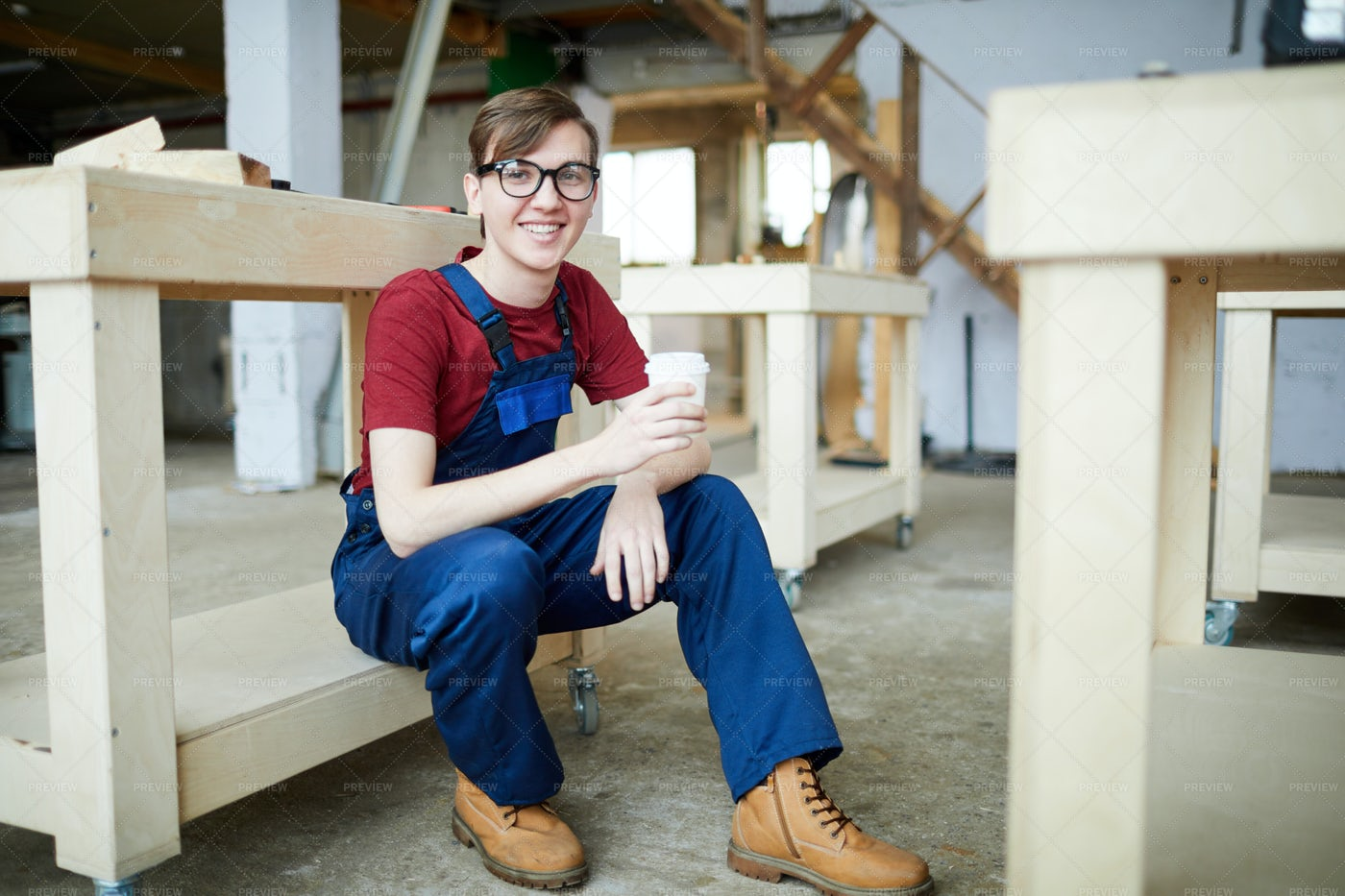 Positive Young Carpenter Drinking: Stock Photos