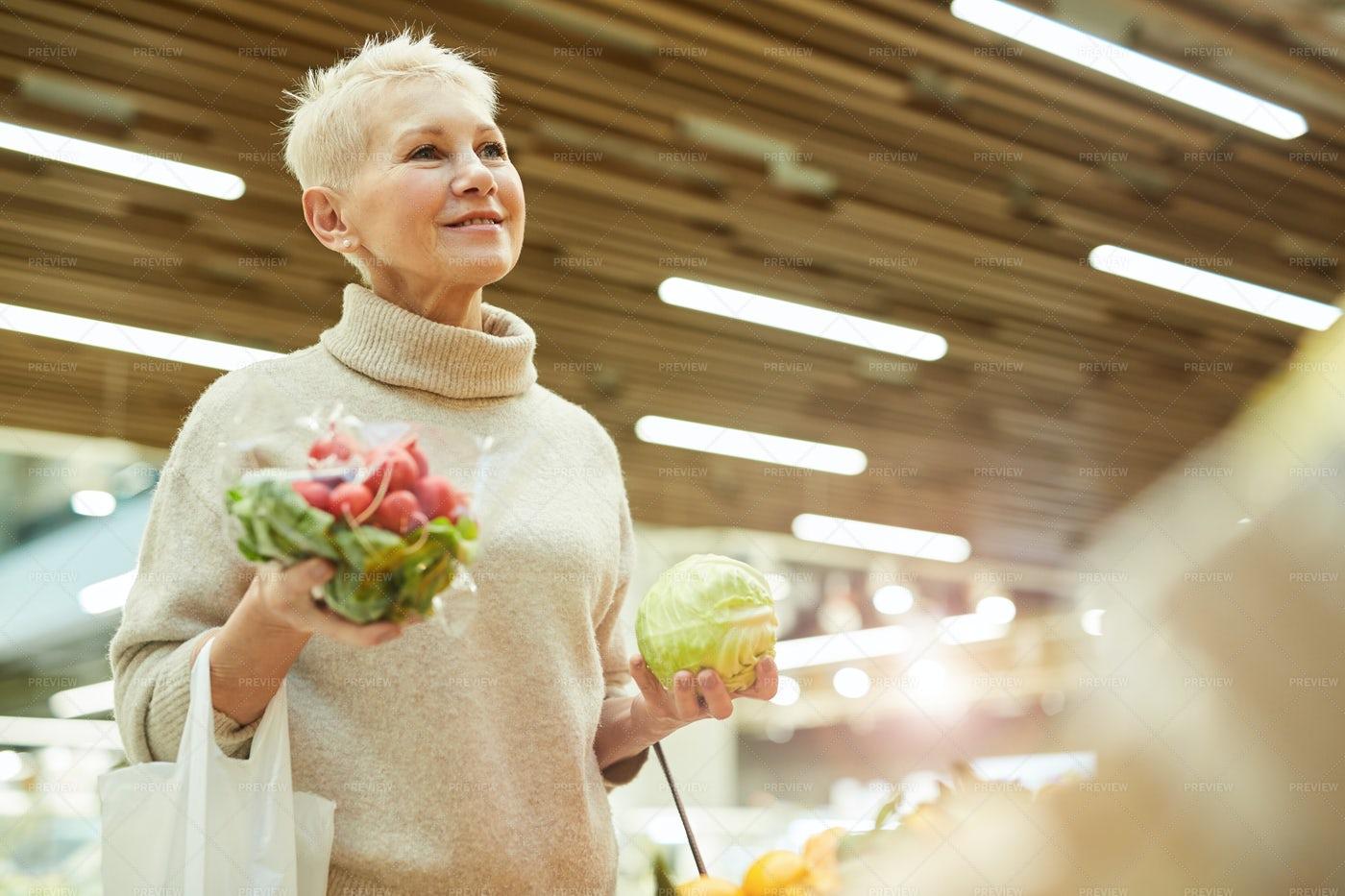 Smiling Woman Buying Fresh...: Stock Photos