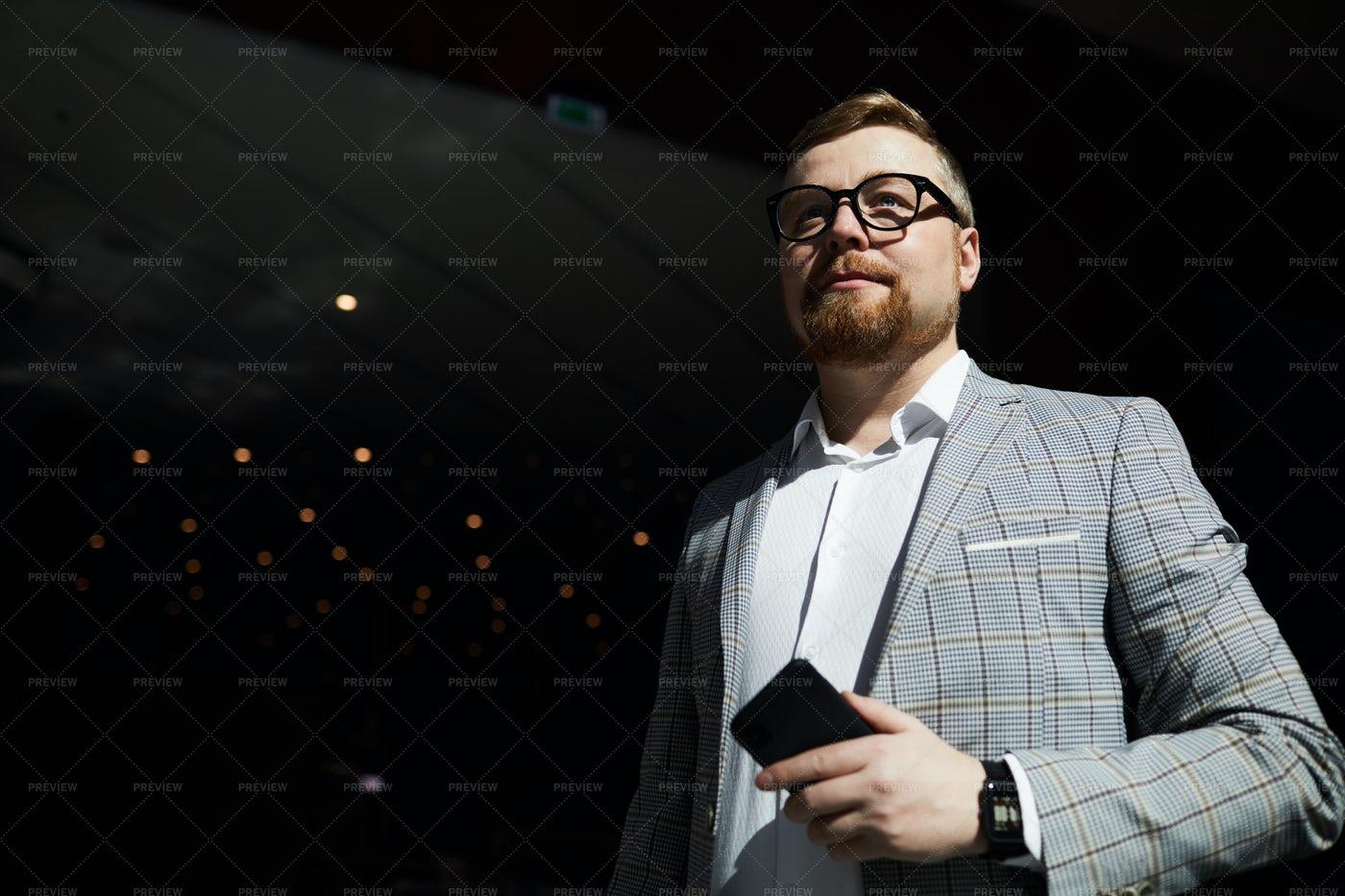 Serious Man Waiting For Business: Stock Photos