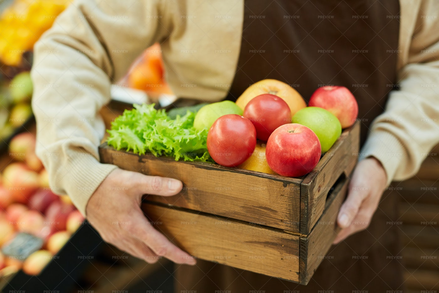 Holding Box Of Produce: Stock Photos