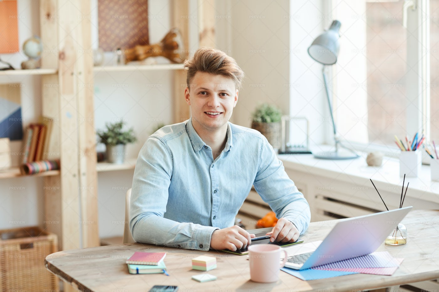 Positive Young Guy At Workplace: Stock Photos