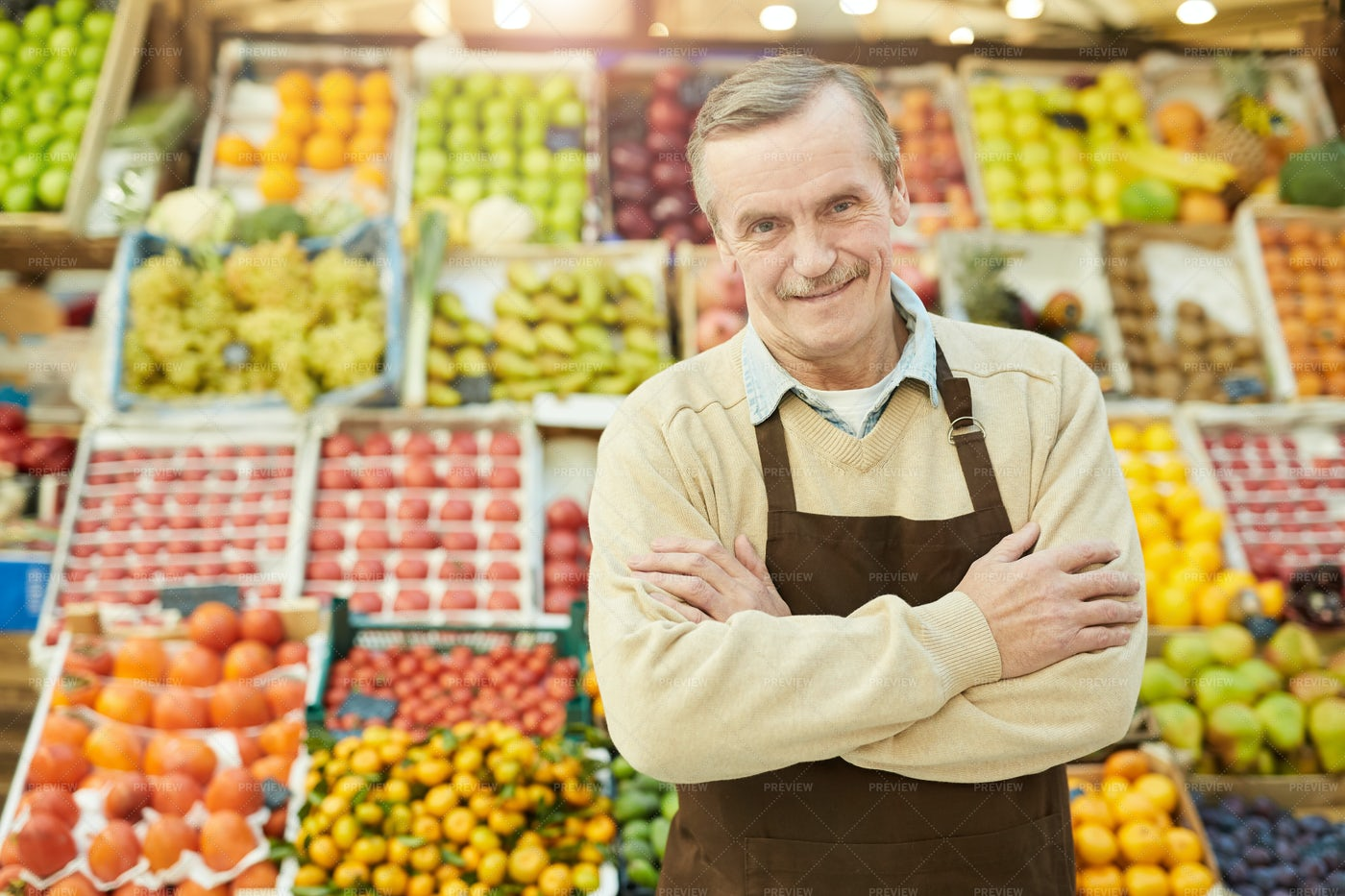 Smiling Senior Man Selling Fruit: Stock Photos