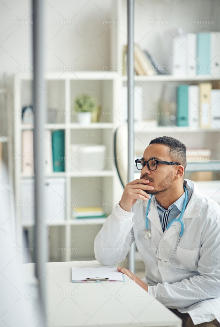 Doctor Using Computer At Workplace: Stock Photos
