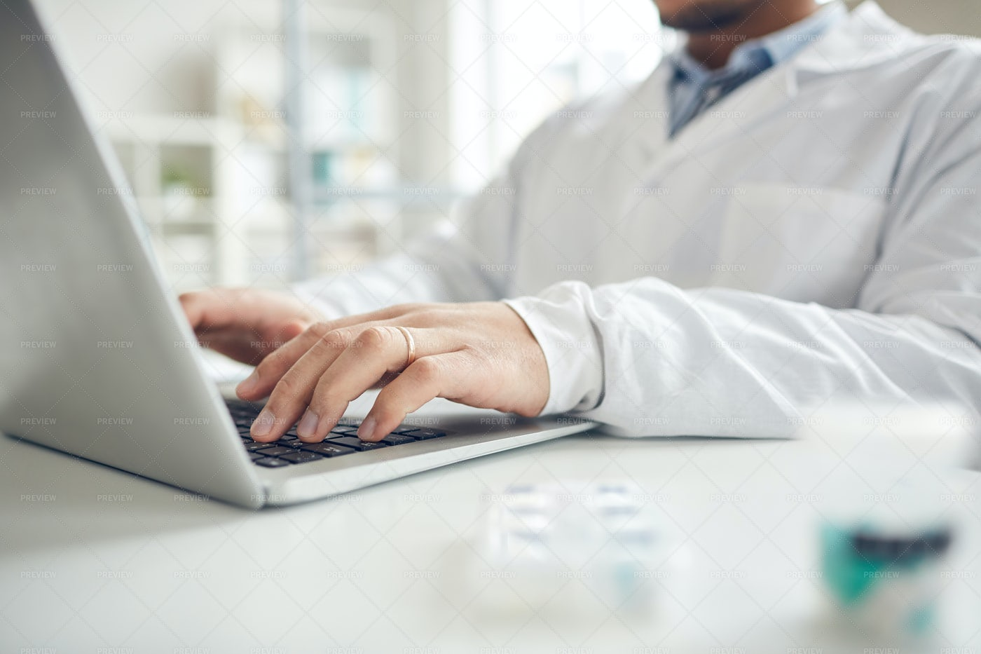 Closeup Of Doctor Typing On Laptop: Stock Photos