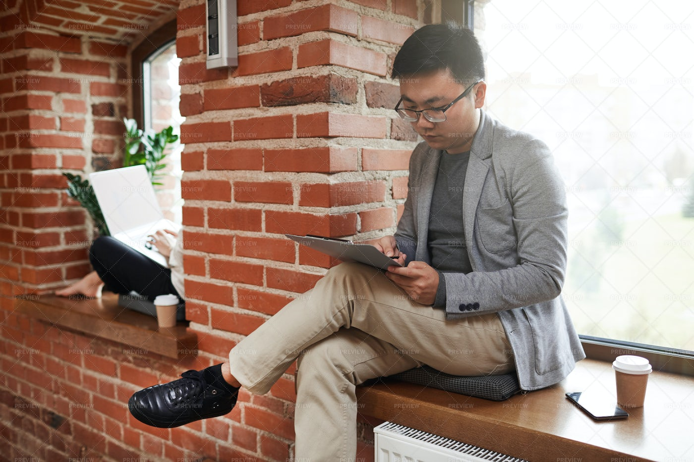 Young Asian Businessman Working: Stock Photos