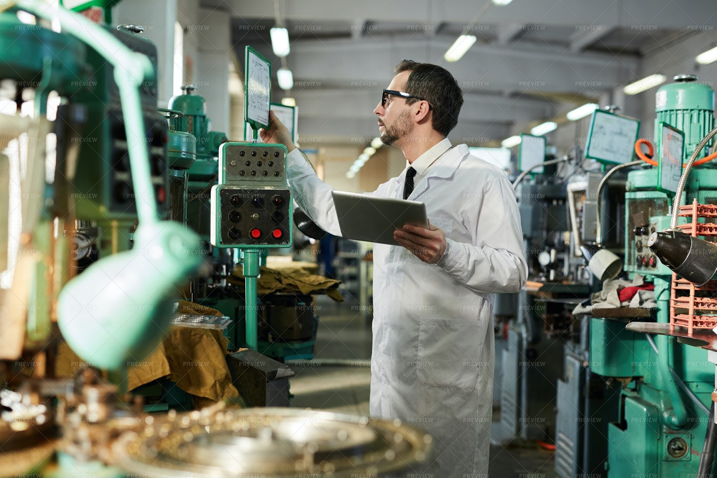 Worker Operating Machines: Stock Photos