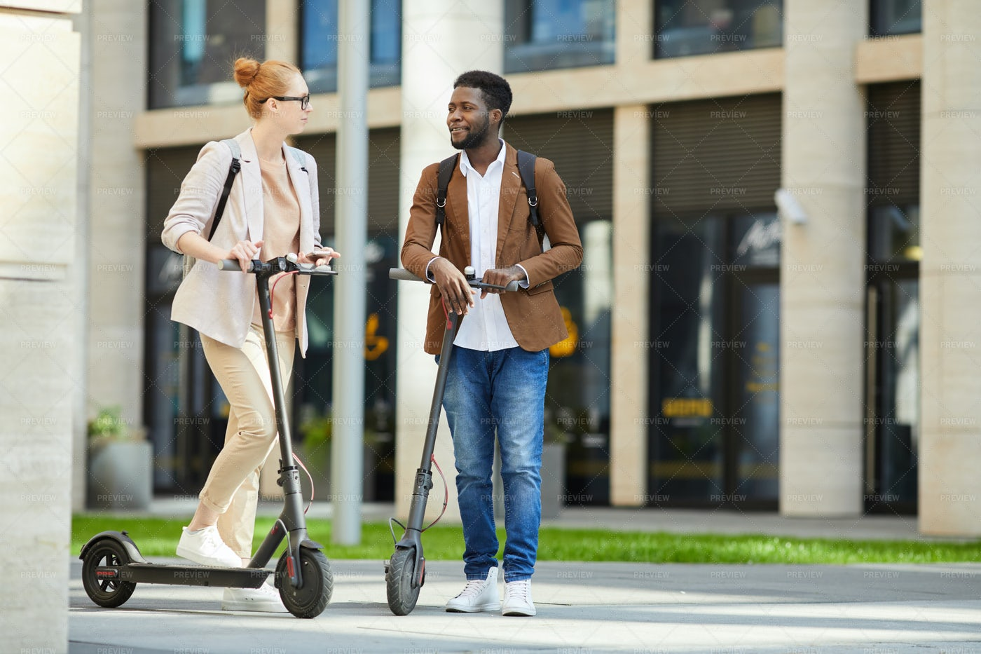 Couple Riding Electric Scooters In...: Stock Photos