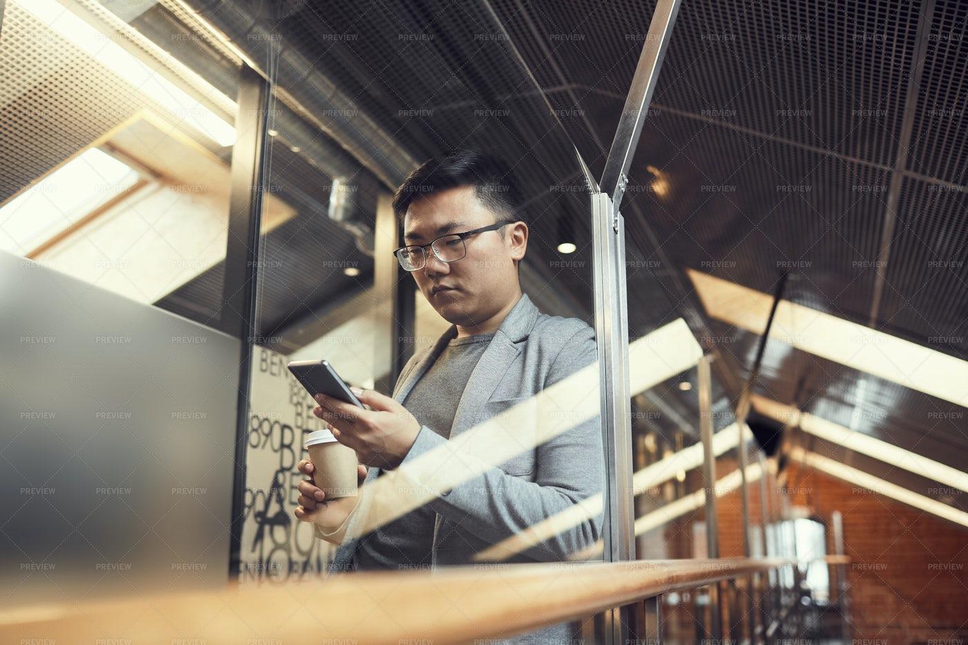 Asian Businessman Using Smartphone...: Stock Photos