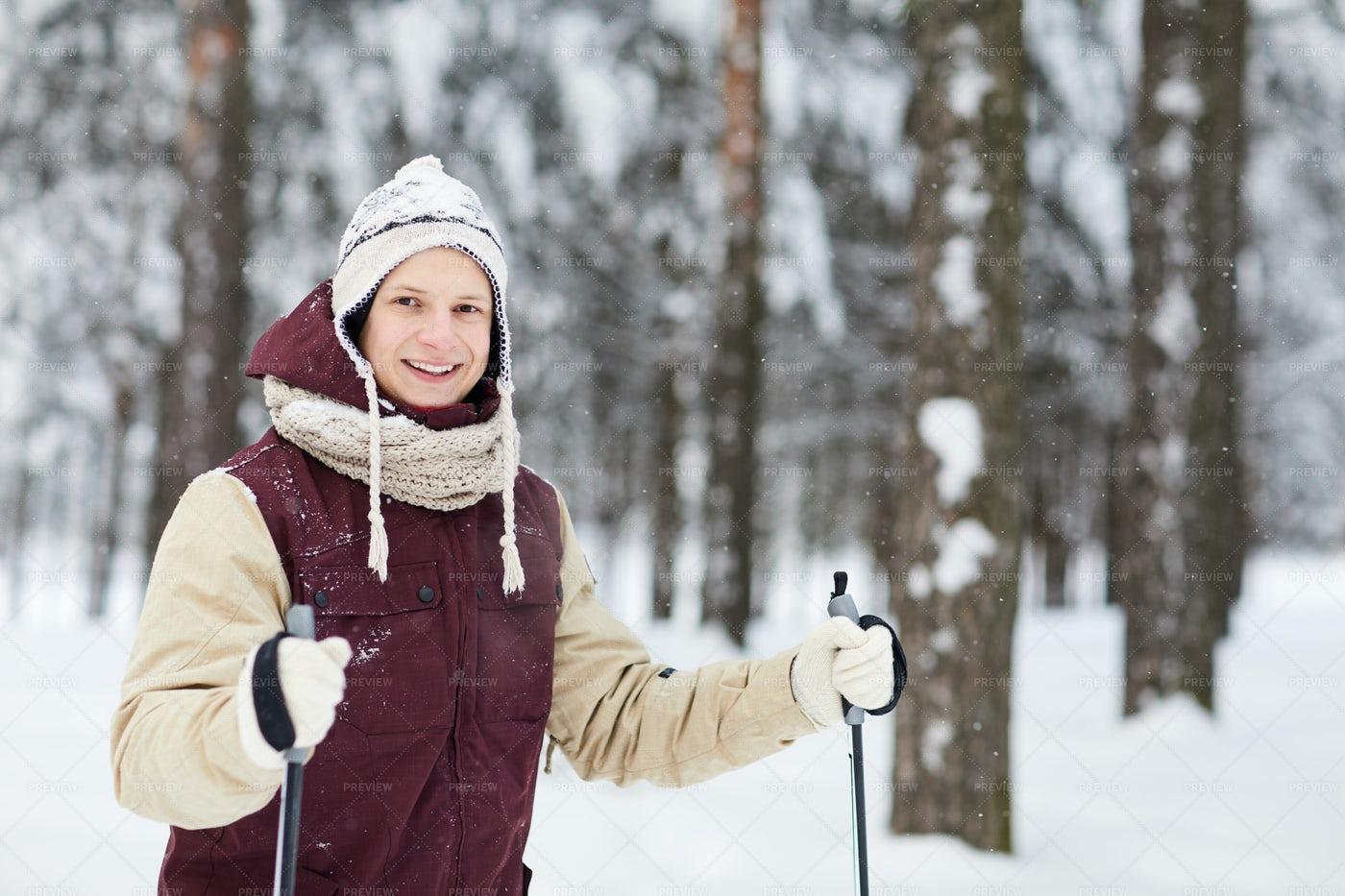 Active Young Man Skiing In Snow: Stock Photos