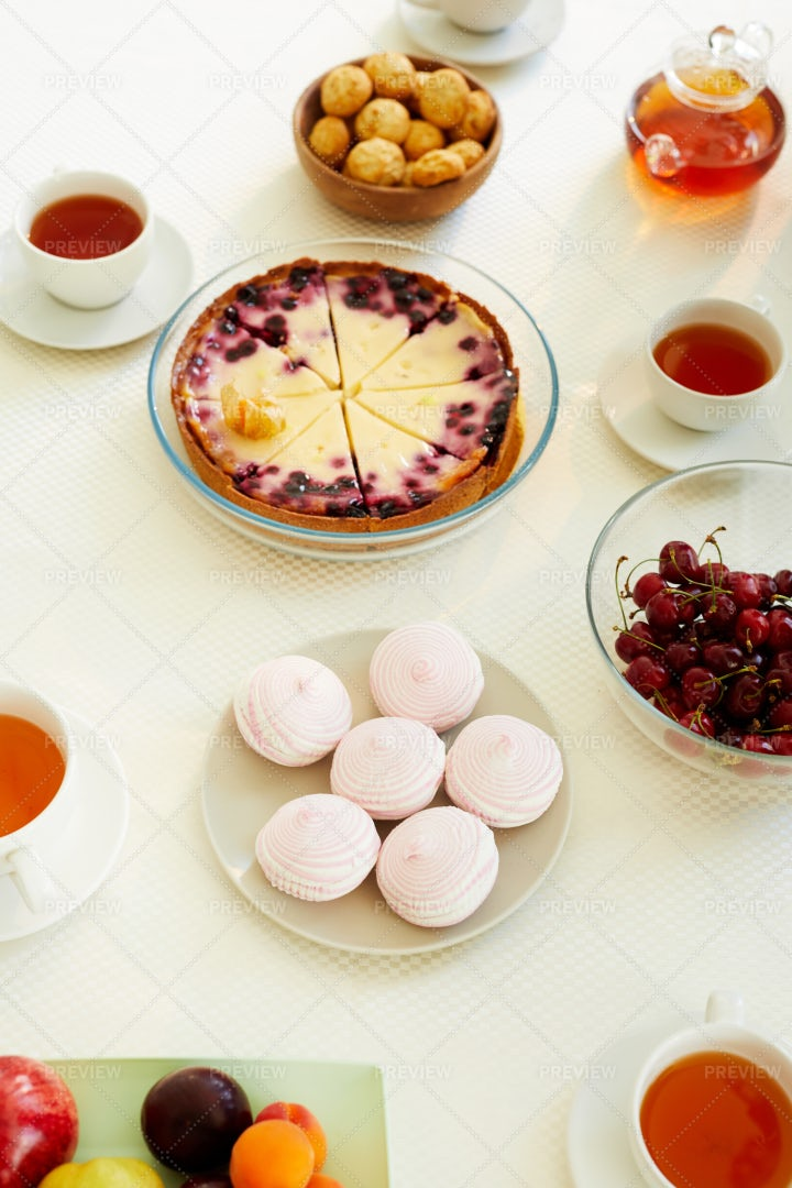 Baked Treats And Fruit On Table: Stock Photos
