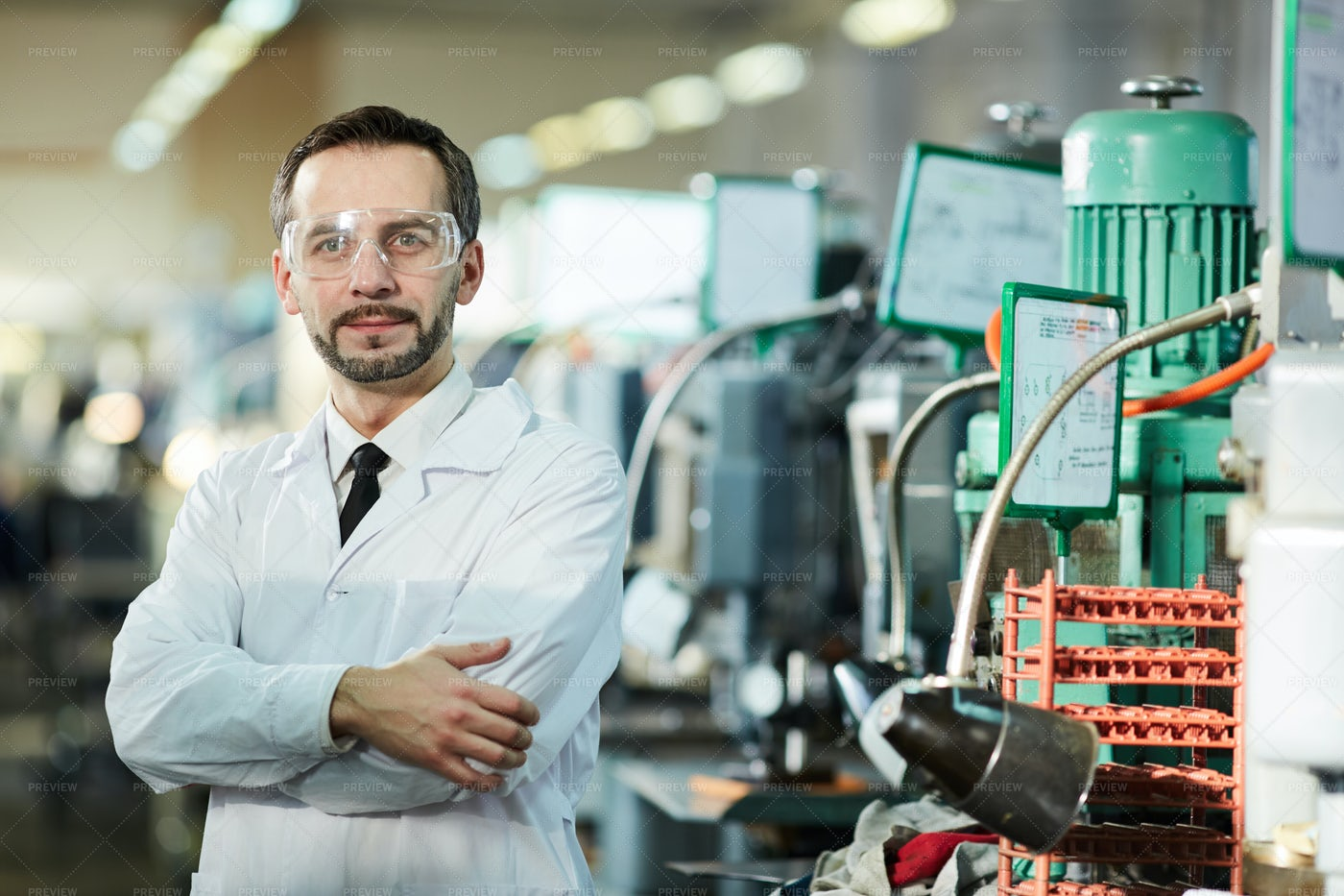 Factory Worker Wearing Lab Coat: Stock Photos