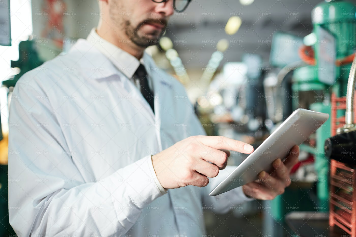 Factory Worker Holding Tablet: Stock Photos