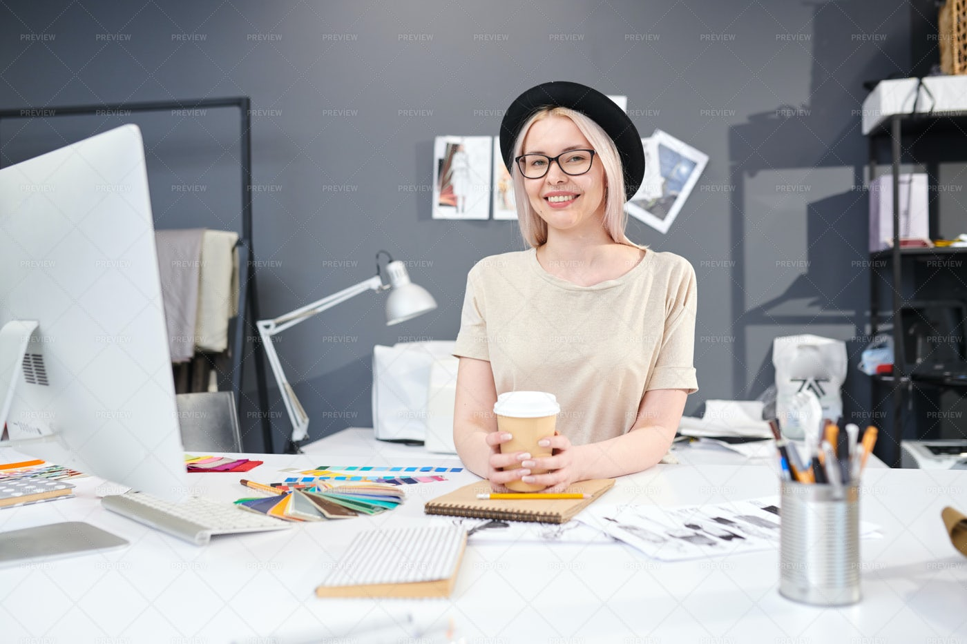 Designer Sitting At Her Workplace: Stock Photos