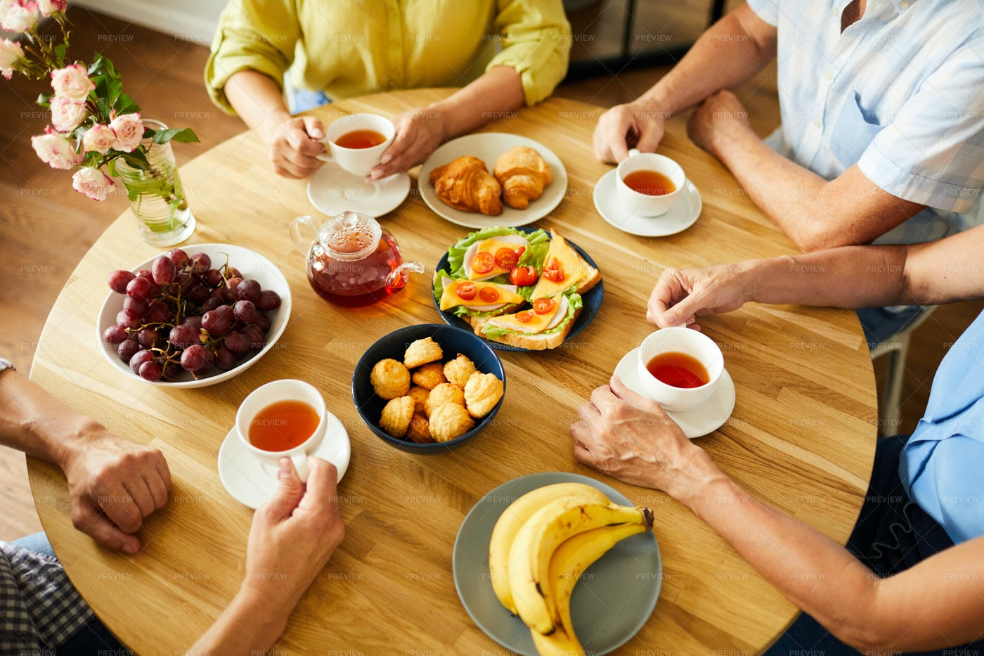 Friends At Round Table With Tea: Stock Photos