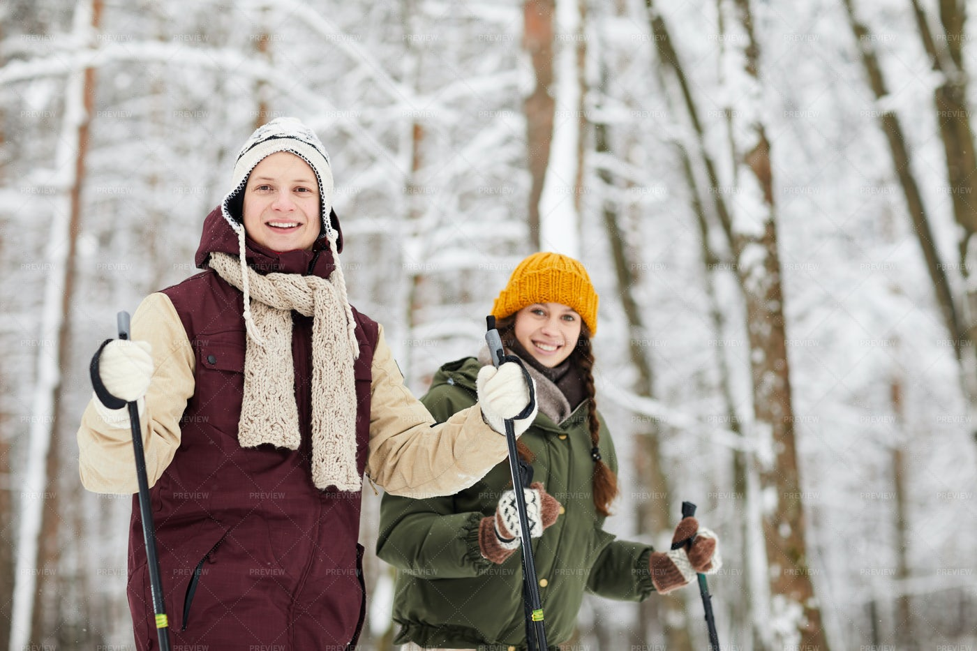 Smiling Couple Skiing In Forest: Stock Photos