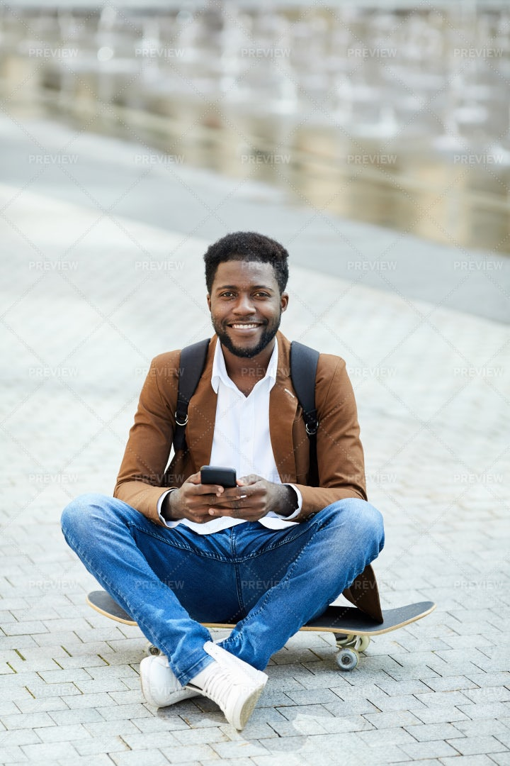 Smiling Man On Skateboard: Stock Photos