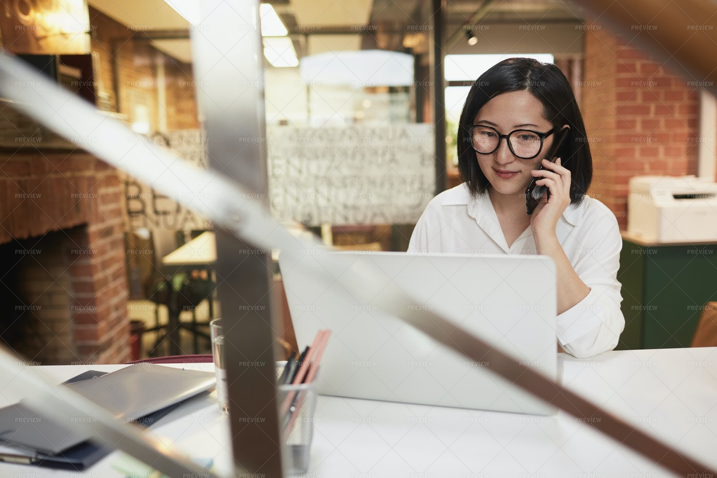 Young Asian Businesswoman Working...: Stock Photos