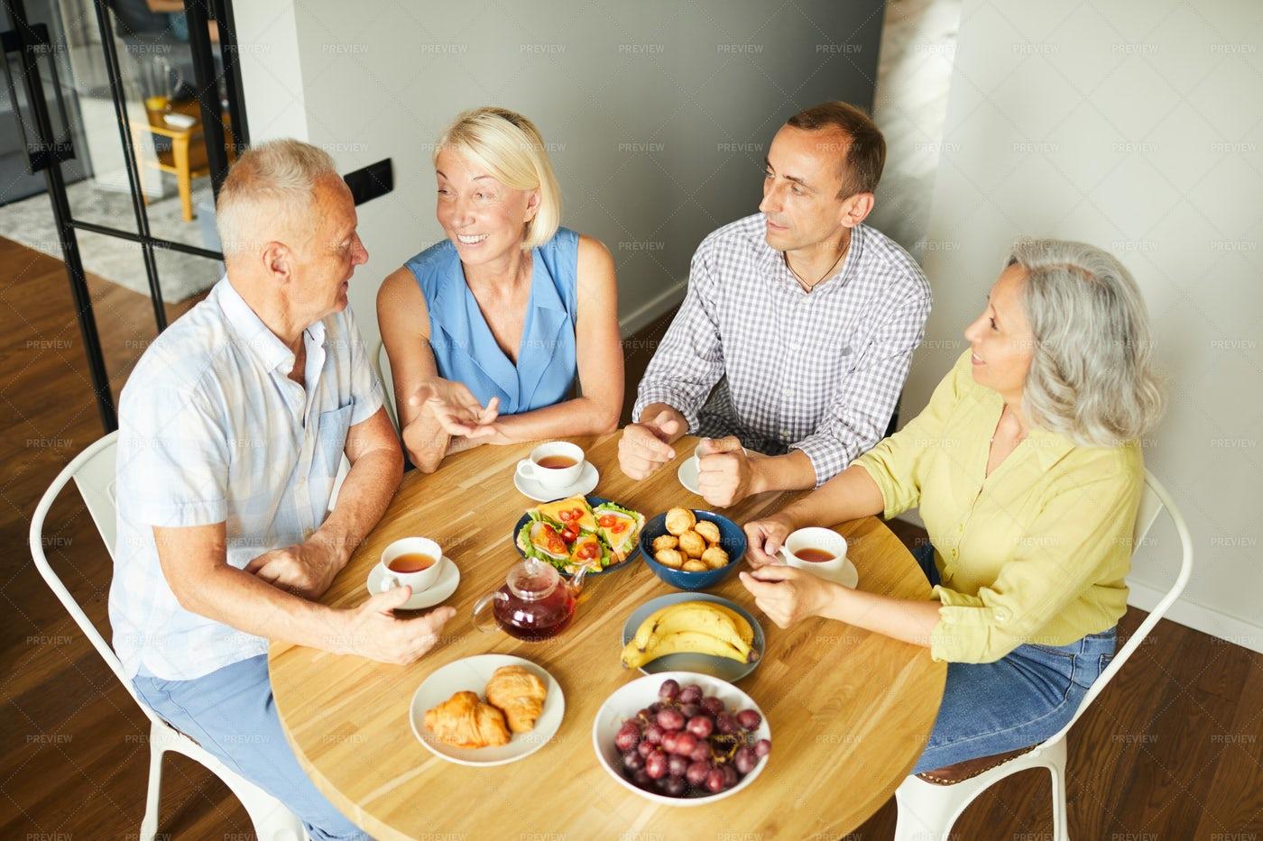 Mature Friends Enjoying Lunch At...: Stock Photos