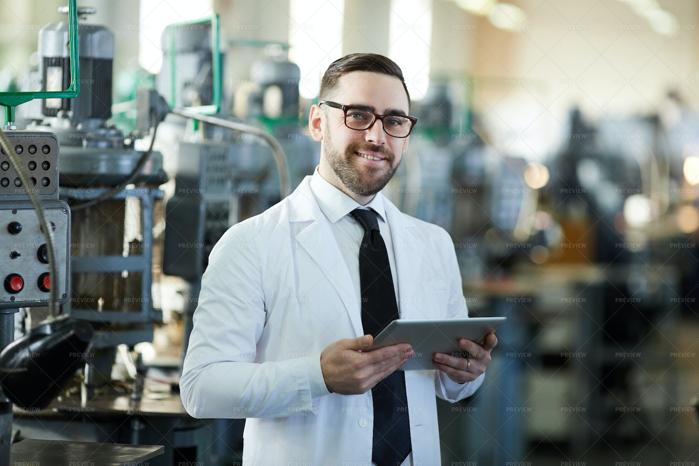 Handsome Factory Manager Holding ...: Stock Photos