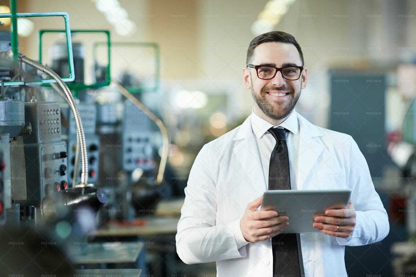 Smiling  Factory Worker  Holding ...: Stock Photos
