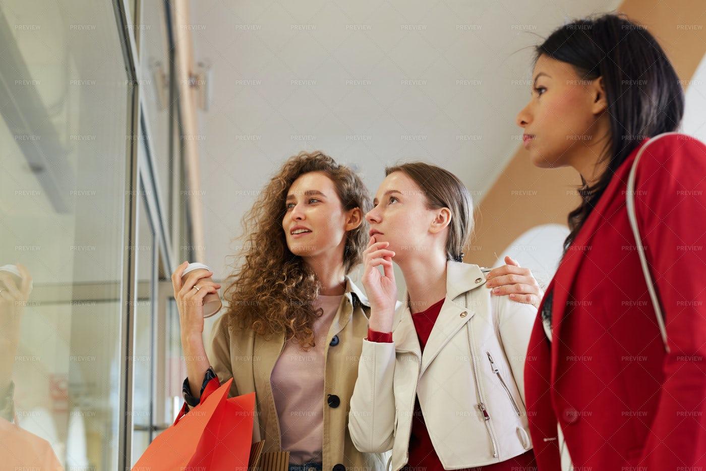 Girls Choosing Dress In Shopping...: Stock Photos