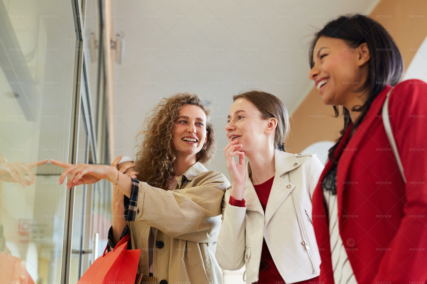Happy Friends Discussing Fashion In...: Stock Photos