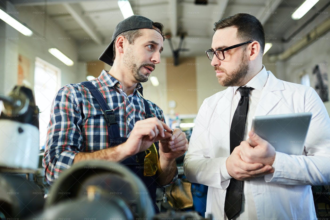 Factory Manager Talking To Worker: Stock Photos