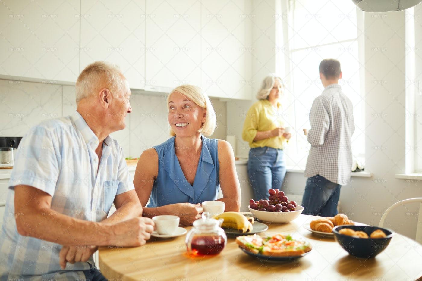 Mature People Drinking Tea In...: Stock Photos