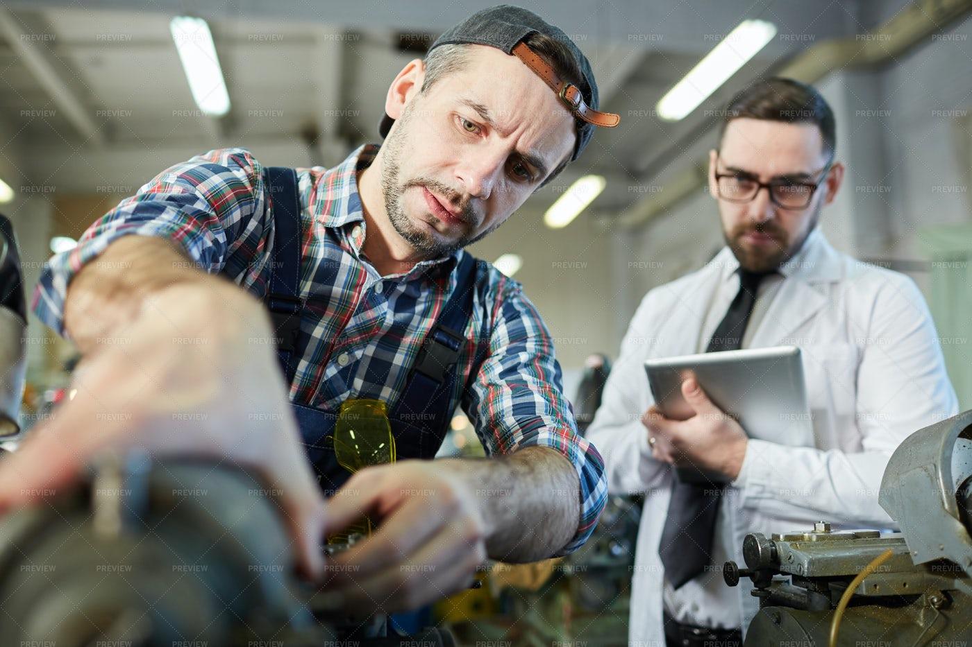 Repairman Fixing Machines At...: Stock Photos