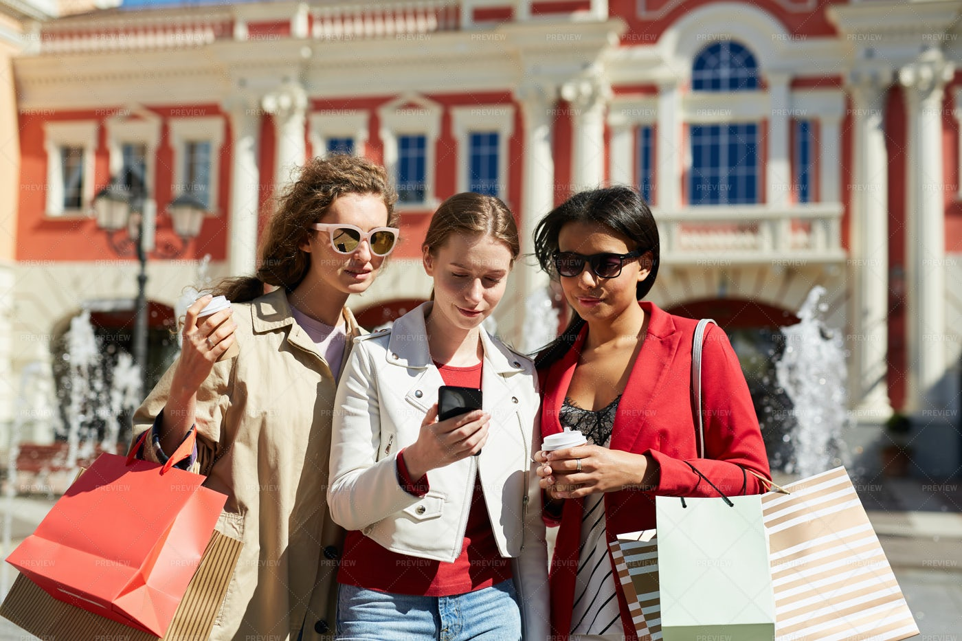 Multi-ethnic Friends Using Shopping...: Stock Photos
