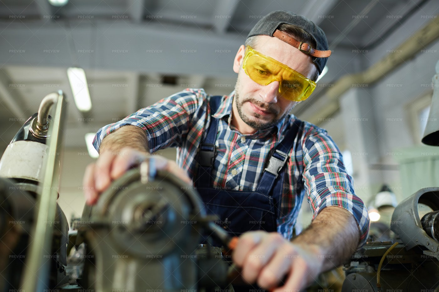 Worker At Metalworking Factory: Stock Photos