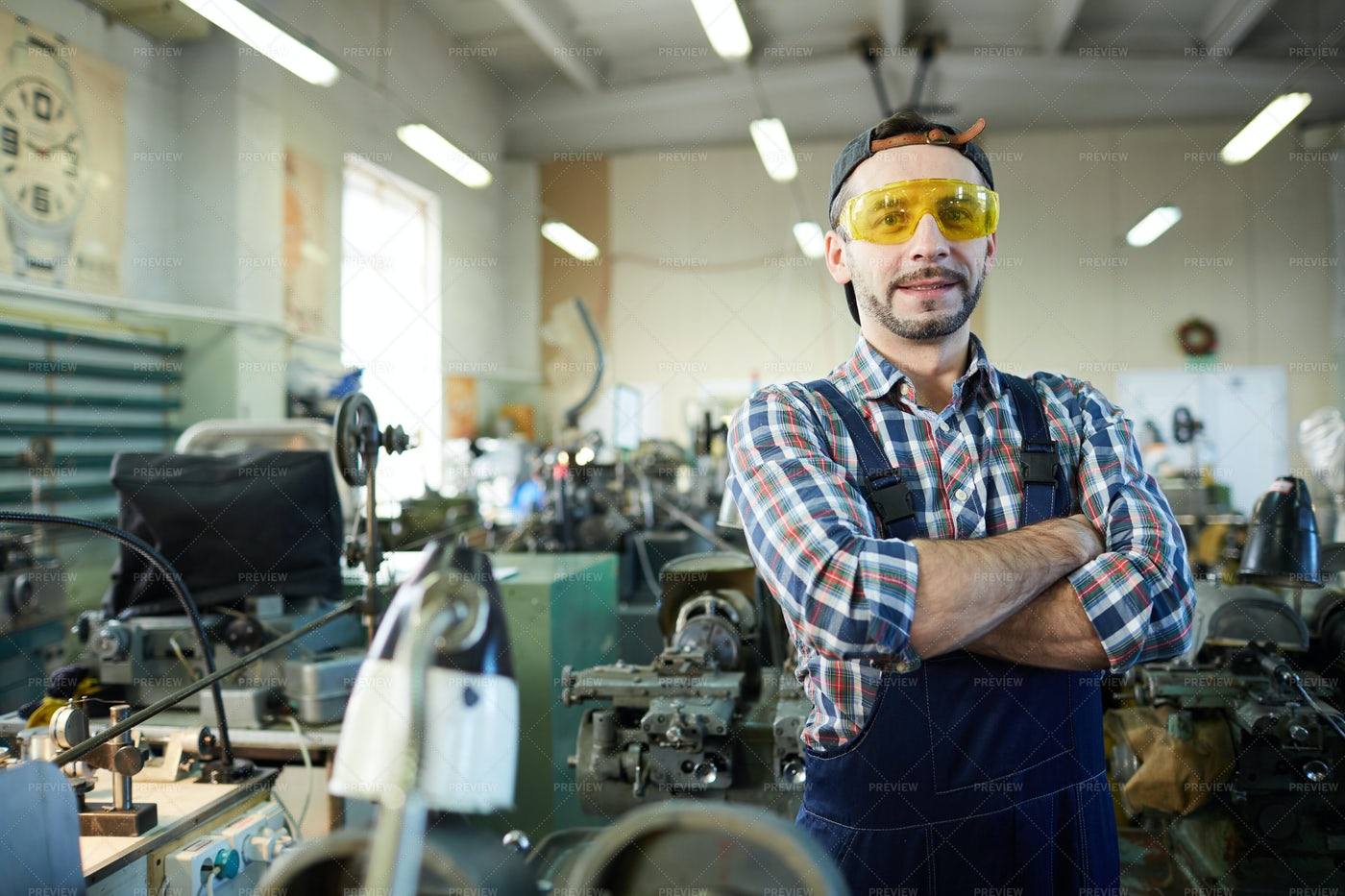 Mature Worker Posing At Industrial...: Stock Photos
