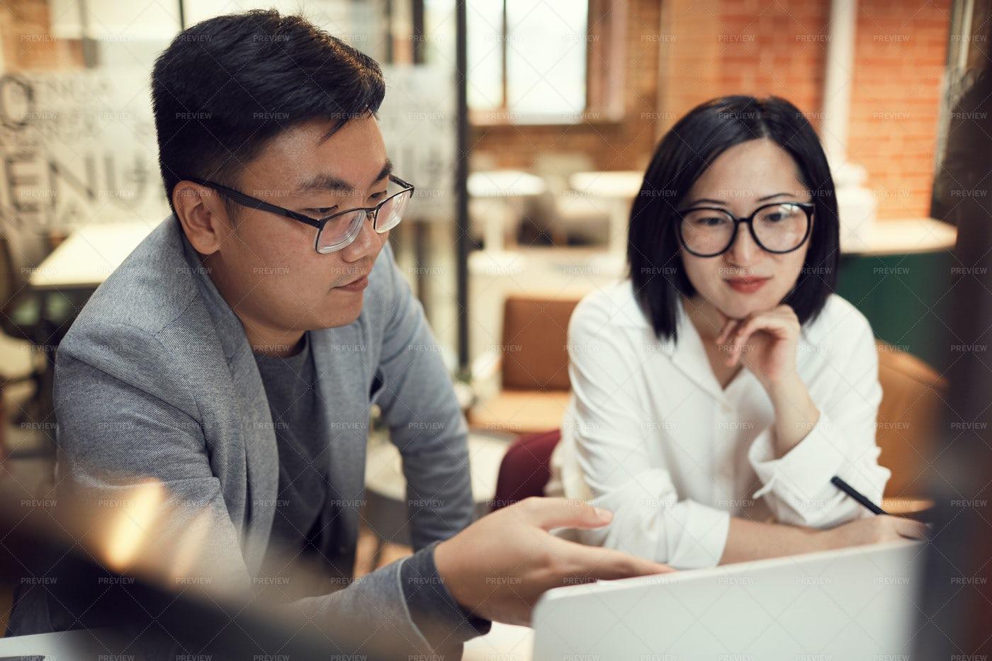 Asian Buisiness People Using Laptop: Stock Photos