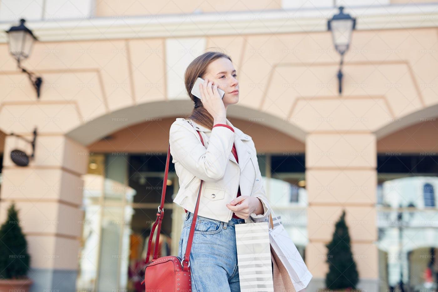 Girl Calling Cab After Shopping: Stock Photos