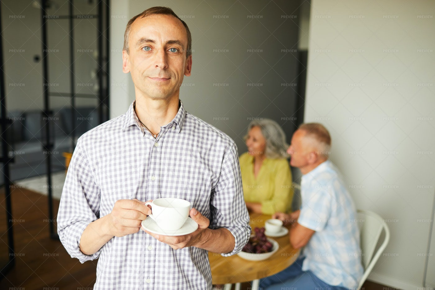 Mature Man Posing With Cup Of Tea: Stock Photos
