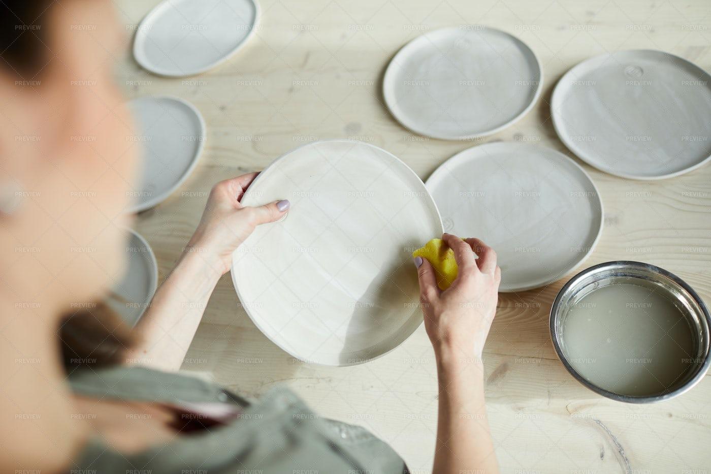 Female Ceramist Making Plates: Stock Photos