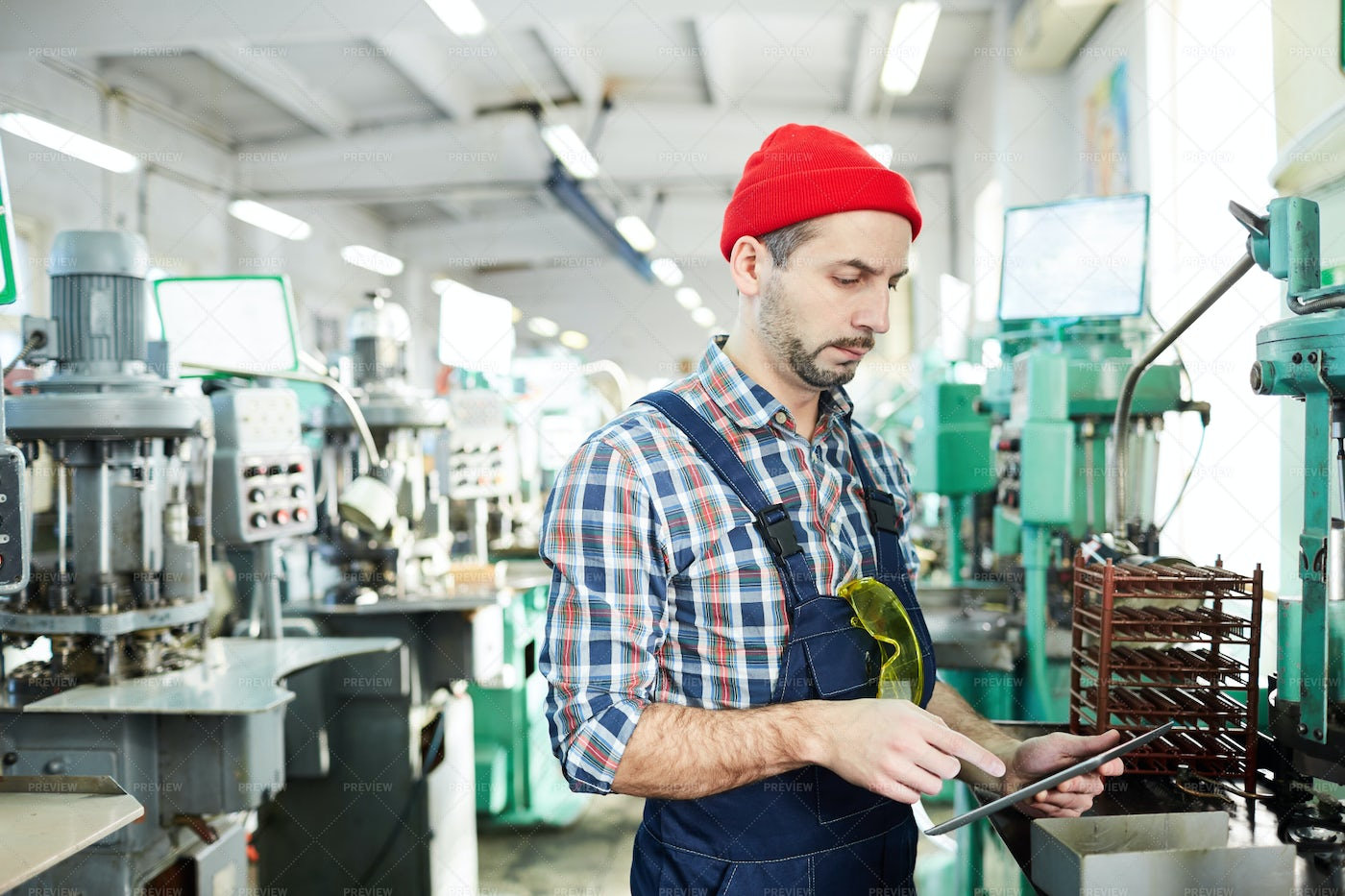 Mature Factory Worker Using Tablet...: Stock Photos