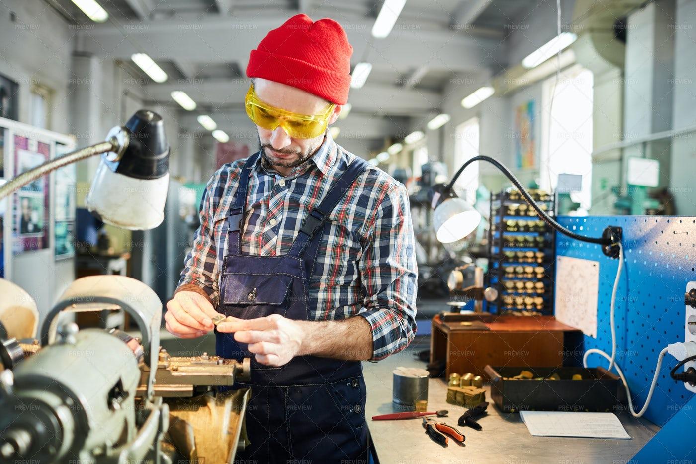 Factory Worker Assembling Mechanism: Stock Photos
