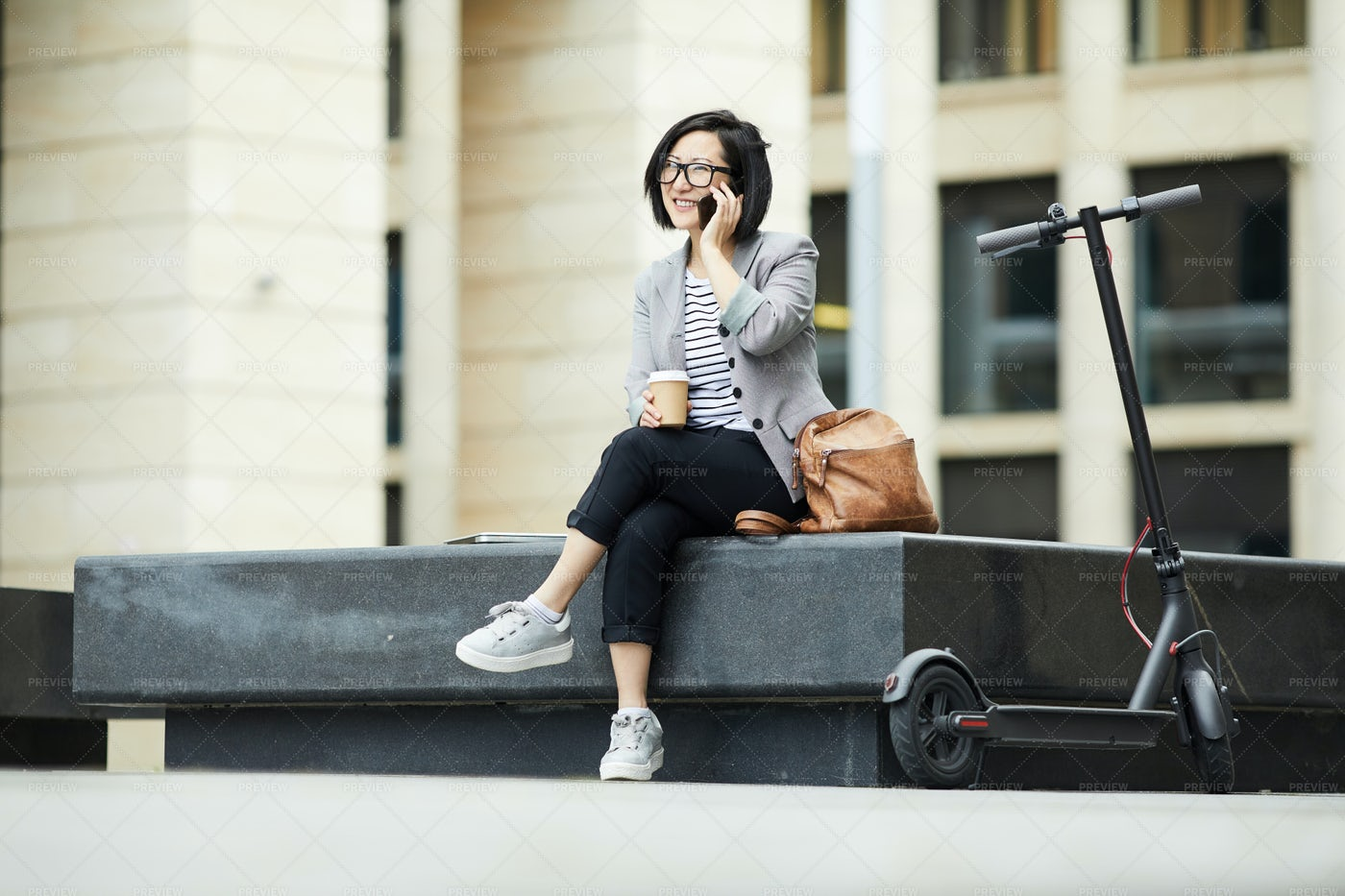 Modern Asian Woman Speaking By...: Stock Photos