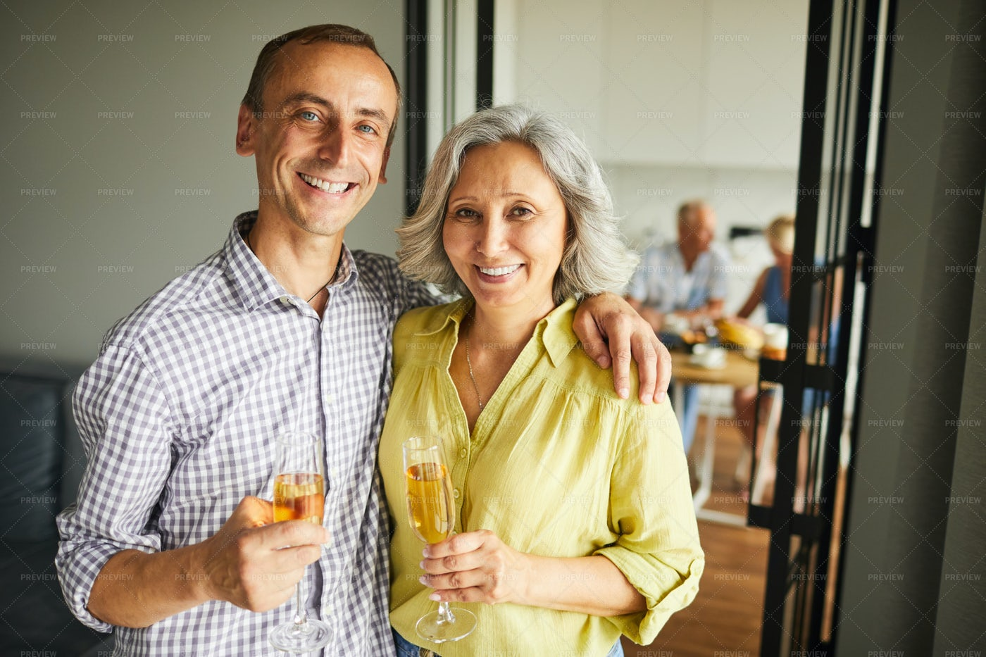 Happy Senior Couple Posing At Party: Stock Photos