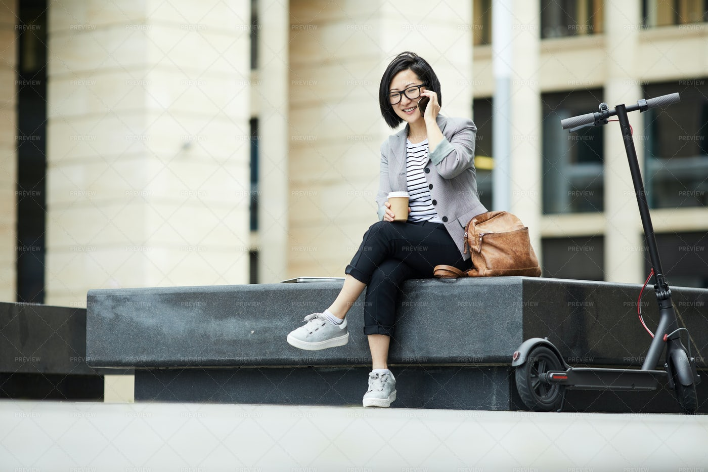 Smiling Asian Woman Speaking By...: Stock Photos