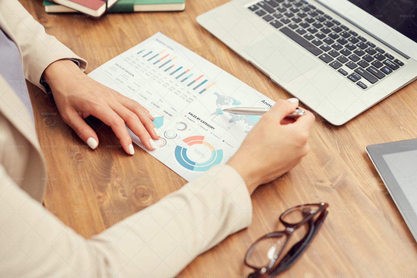 Businesswoman Analyzing Data Close...: Stock Photos