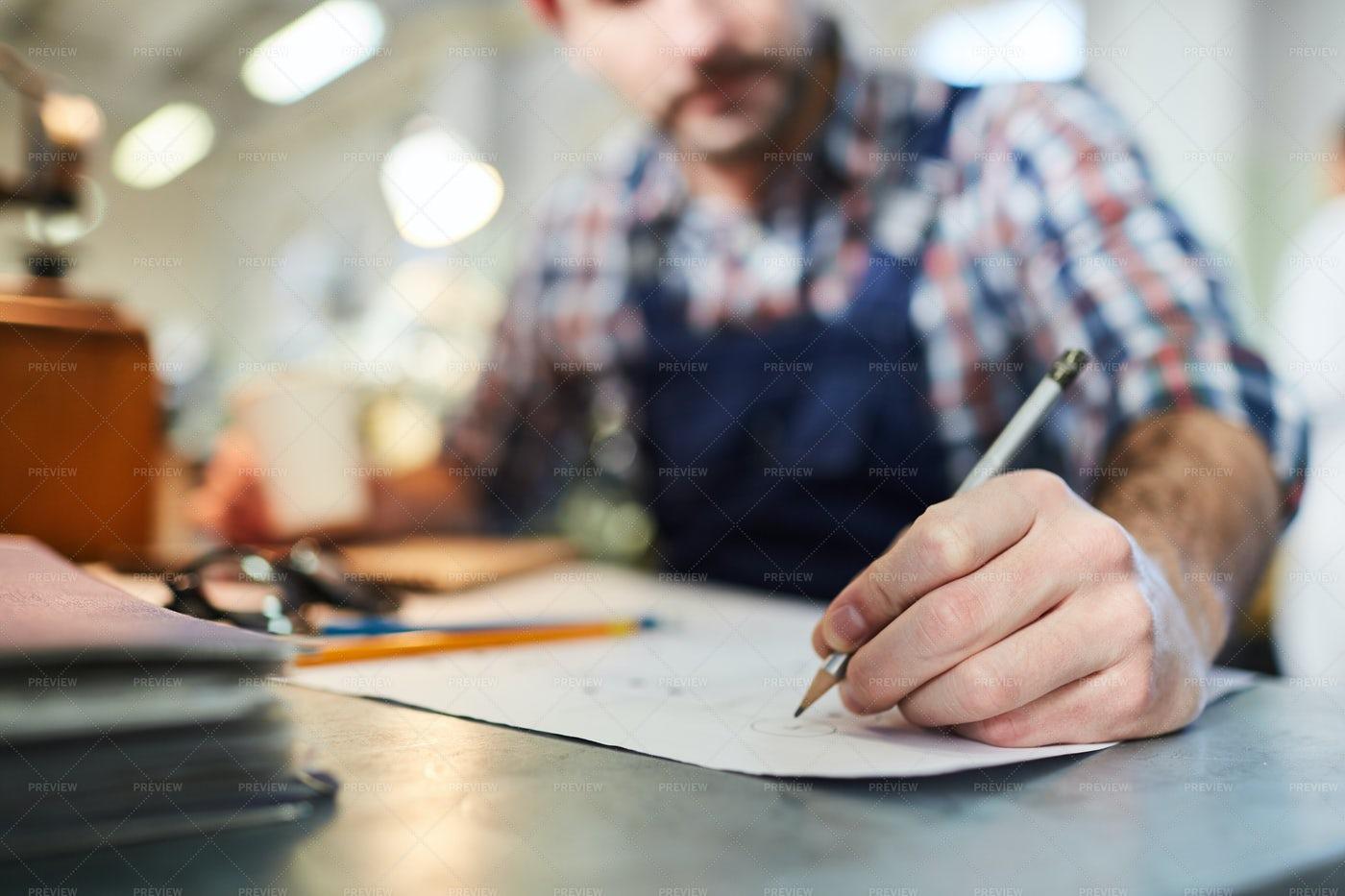 Worker  Drawing Plans Closeup: Stock Photos